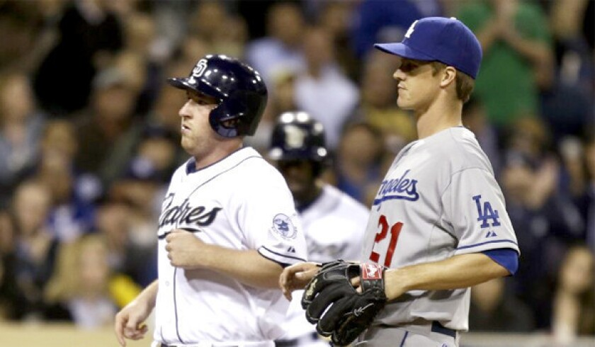 San Diego Padres president and chief executive Tom Garfinkel has apologized for comments he made regarding Zack Greinke in which he appeared to mock the Dodgers pitcher's social anxiety disorder.