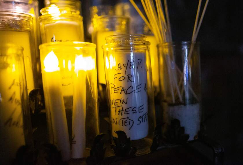 """Candles with messages written are pictured during a """"Unity Vigil"""" ahead of the 59th inaugural ceremony."""