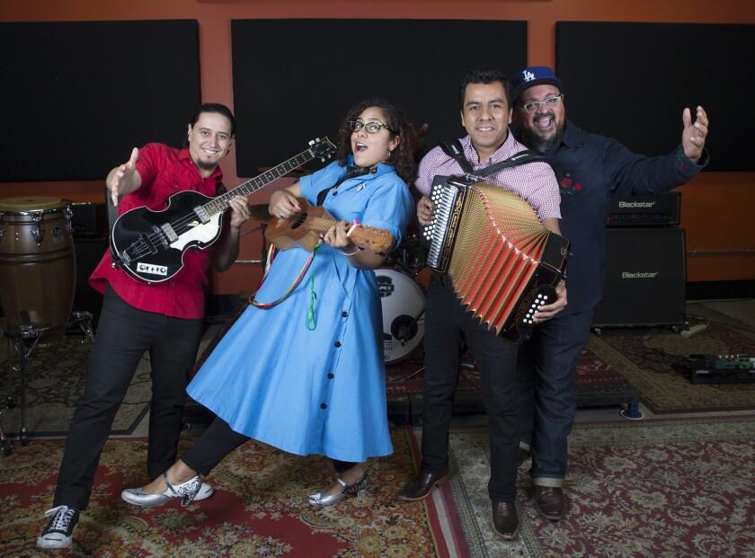 La Santa Cecilia members from left: bassist Alex Bendaña, vocalist Marisol Hernandez, accordionist Jose Carlos and percussionist Miguel Ramirez.