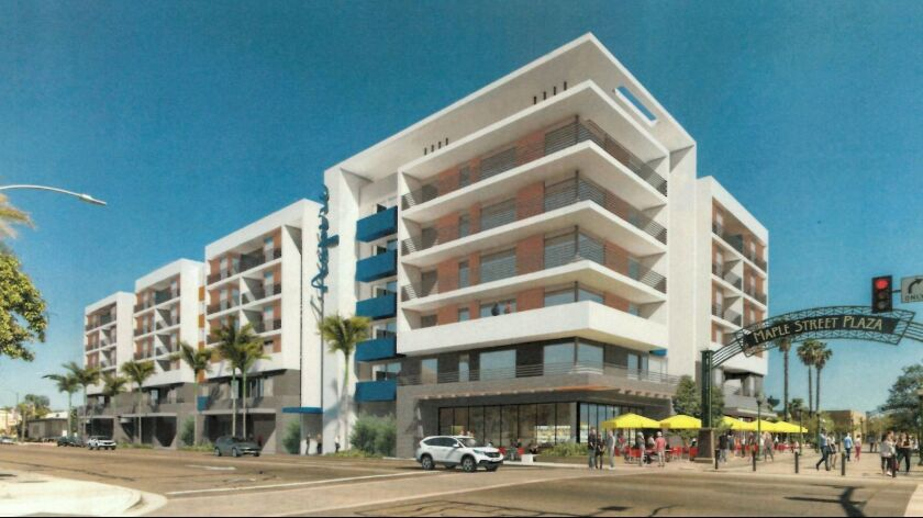 The Aspire condominium project would be built where the city's parking lot located behind Grand Aven