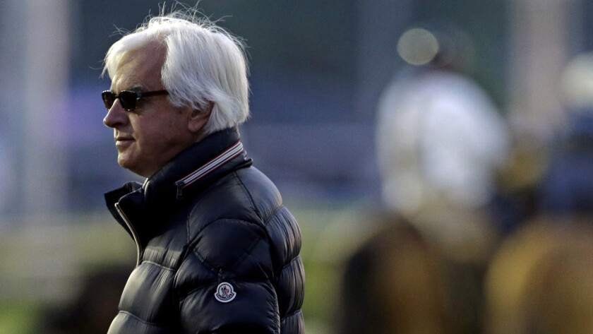 Bob Baffert watches morning workouts at Churchill Downs in Louisville, Ky., on May 1, 2014.