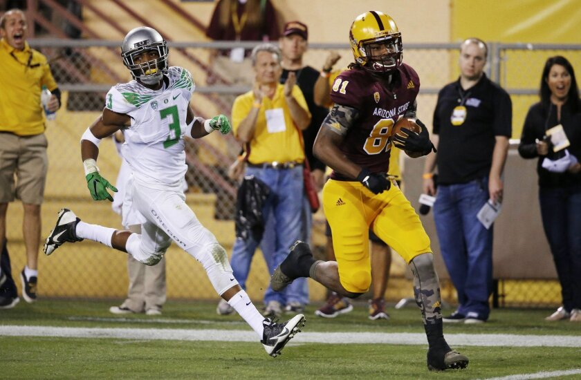 Arizona State's Gary Chambers (81) scores a touchdown as he beats Oregon's Tyree Robinson (3) to the end zone during the first half of an NCAA college football game Thursday, Oct. 29, 2015, in Tempe, Ariz. (AP Photo/Ross D. Franklin)