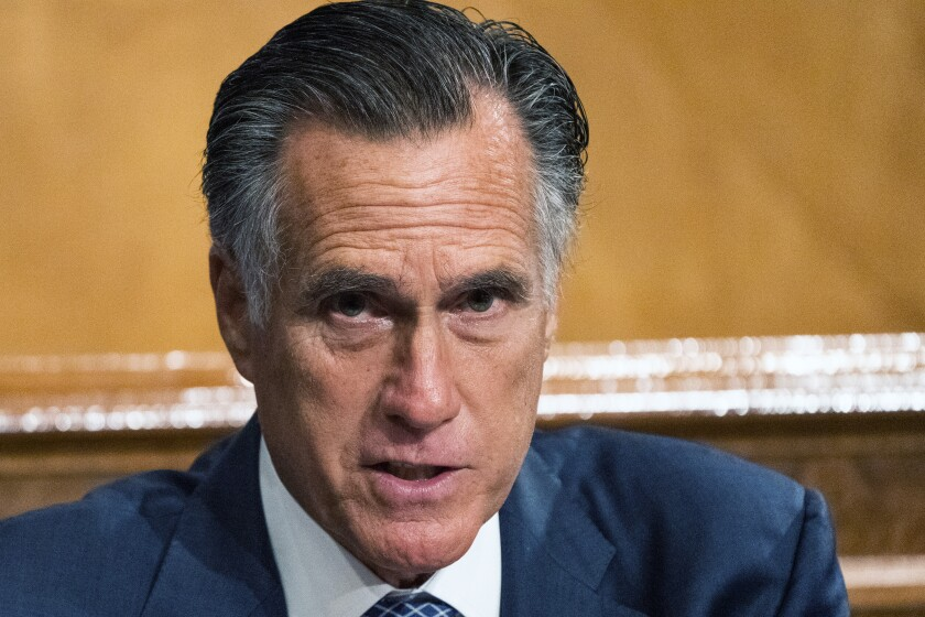 """Senate Homeland Security and Governmental Affairs Committee member Sen. Mitt Romney, R-Utah, speaks during the committee's business meeting where it will consider new subpoenas in the """"Crossfire Hurricane""""/Burisma investigation on Capitol Hill, Wednesday, Sept. 16, 2020, in Washington. (AP Photo/Manuel Balce Ceneta)"""