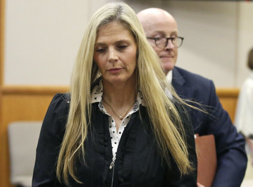 Olympic gold-medal skier Picabo Street leaves the courtroom Tuesday, Feb. 16, 2016, in Park City, Utah. Street appeared in court Tuesday on misdemeanor domestic violence and assault charges. Street is accused of throwing her 76-year-old father down stairs and locking him in a basement during a figh