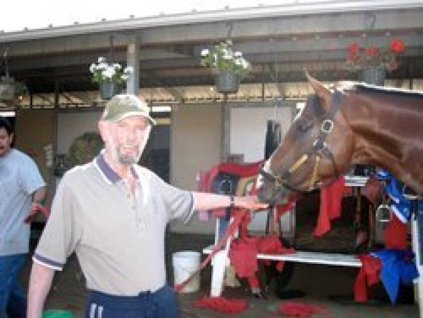 Local resident Bill Currin, with his 3-year-old stakes winner, My Best Brother. Photo/Julie Sarno