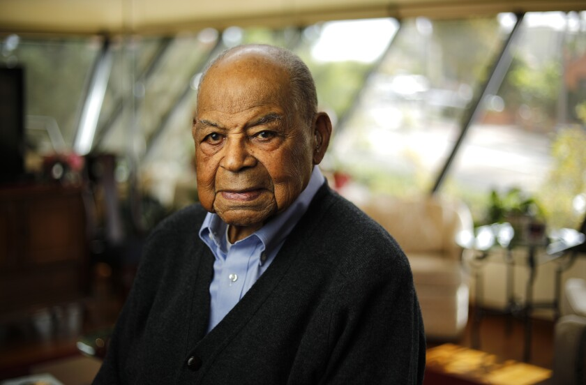 """""""I encouraged a lot of people who didn't realize that they were able to buy,"""" said Theo Logan, 102, a retired real estate agent."""