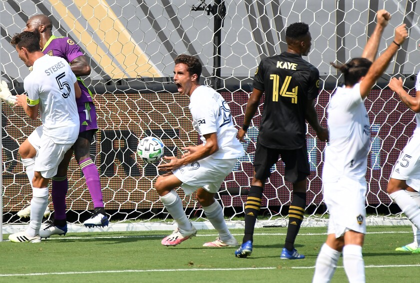 The Galaxy's Ethan Zubak, center, celebrates his goal against LAFC in the first half Aug. 22, 2020.