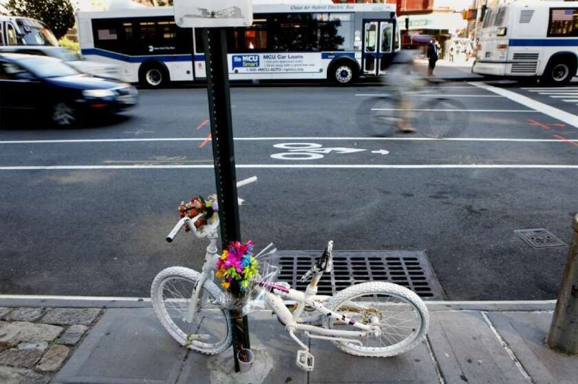Ghost bikes like this one in New York often mark the spot where a cyclist was killed.