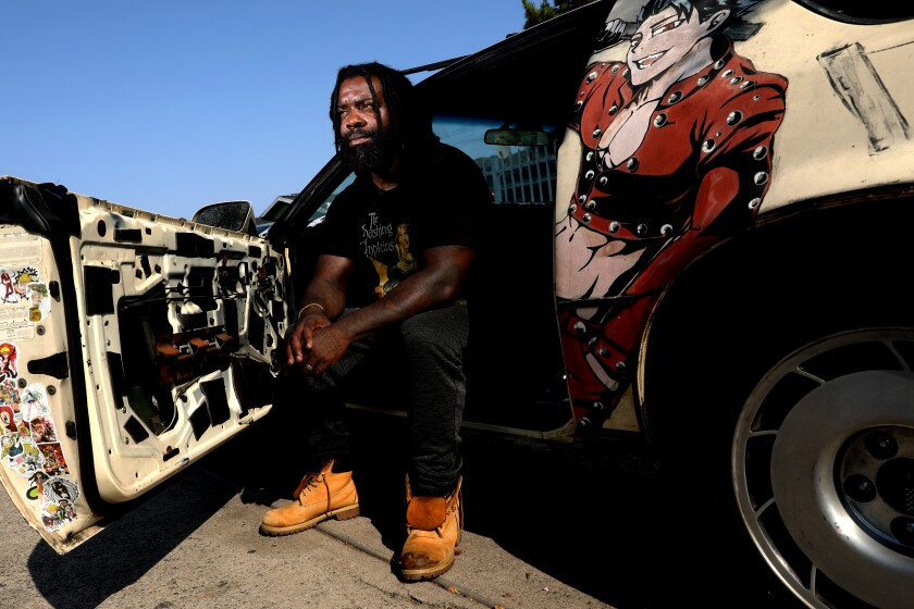 LOS ANGELES, CA - AUGUST 15: Bryant Mangum, 39, at his home on Sunday, Aug. 15, 2021 in Los Angeles, CA. Magnum says he's been racially profiled and pulled over without cause by LAPD many times. Once, they dragged him out of his car and arrested him for being double parked in front of his own house. Los Angeles Department of Transportation to study removing Los Angeles Police Department from traffic stops. (Gary Coronado / Los Angeles Times)