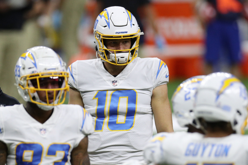 Chargers rookie quarterback Justin Herbert looks on from the field during Monday's loss to the New Orleans Saints.