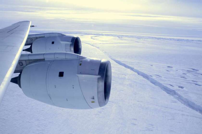 British researchers have revealed a Grand Canyon-size chasm under Antarctic ice. Above, a NASA research plane flies over the Pine Island Glacier ice shelf in Antarctica in 2011.