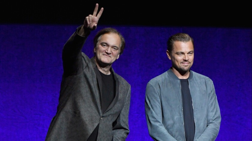 Quentin Tarantino, left, and Leonardo DiCaprio surprised movie theater owners at CinemaCon on Monday.