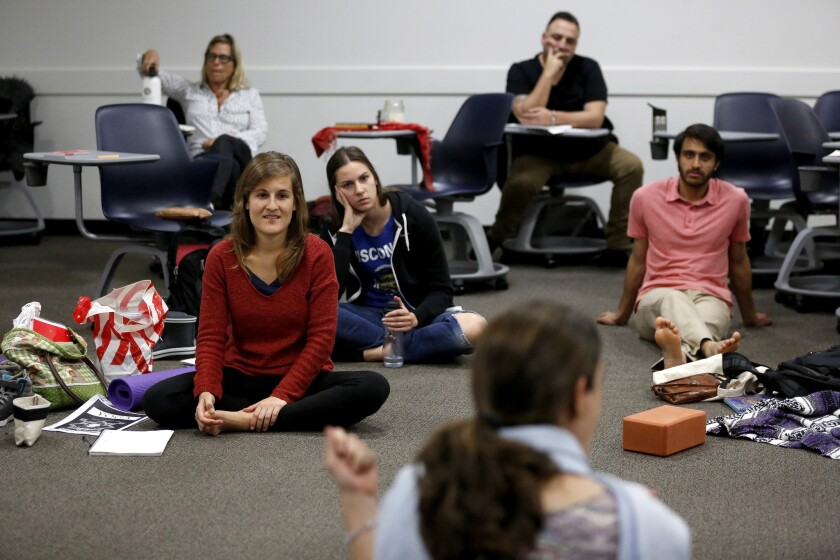 First-year master's degree in yoga students attend a class taught by professor Ana Funes at Loyola M