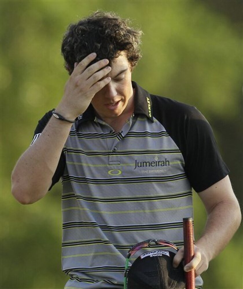 Rory McIlroy of Northern Ireland wipes his forehead after his final round of the Masters golf tournament Sunday, April 10, 2011, in Augusta, Ga. (AP Photo/David J. Phillip)