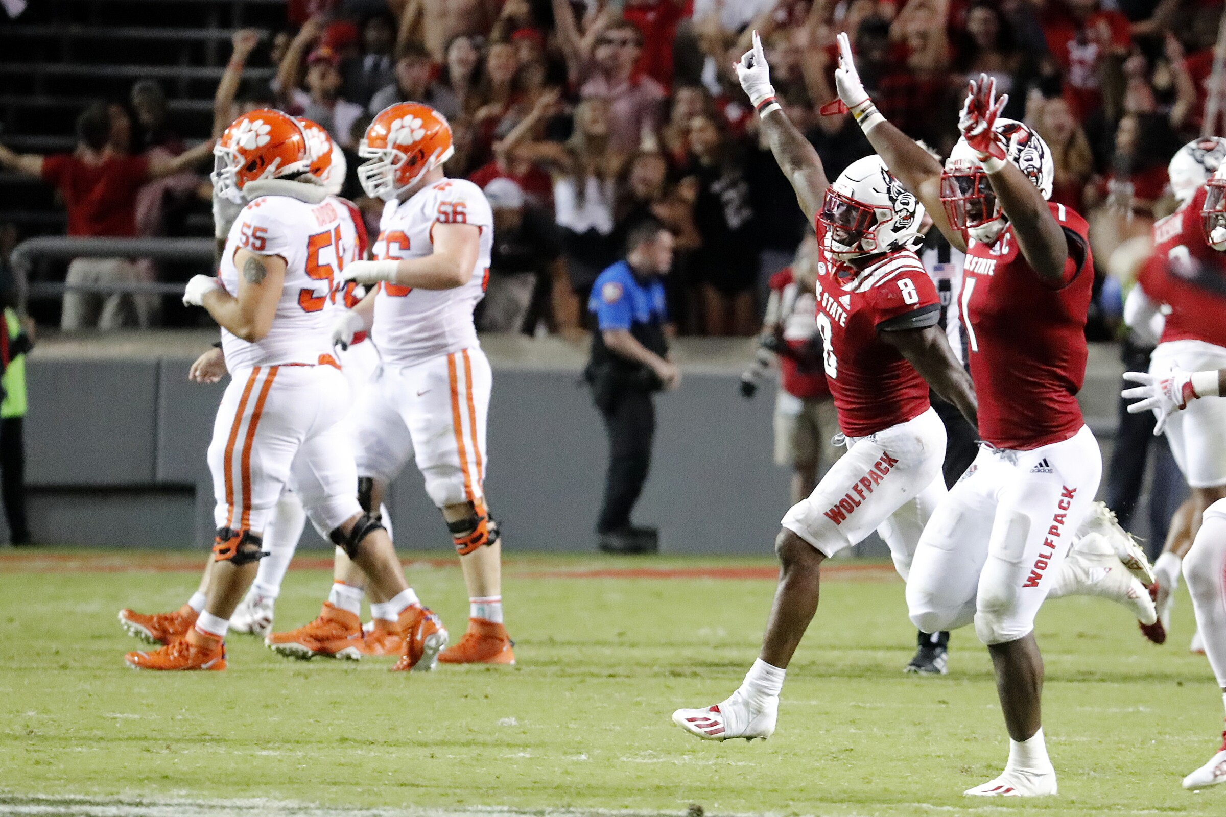 North Carolina State players celebrate after they defeated Clemson in overtime Saturday.