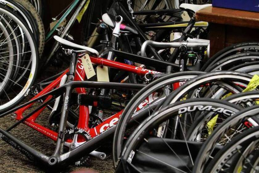 Sheriff's investigators display some of the recovered racing bicycles that were stolen from victims found through Facebook and Craigslist.