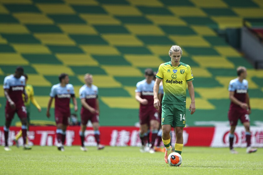 Norwich City's Todd Cantwell is dejected after West Ham scored their fourth goal during the English Premier League soccer match between Norwich City and West Ham at the Carrow Road stadium in Norwich, England, Saturday, July 11, 2020. (Alex Pantling/Pool via AP)