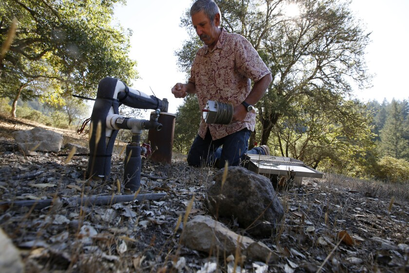 Ray Waldbaum checks the water level in the well at his home in the Mayacamas Mountains in Santa Rosa. The water level has dropped 10 feet since May.