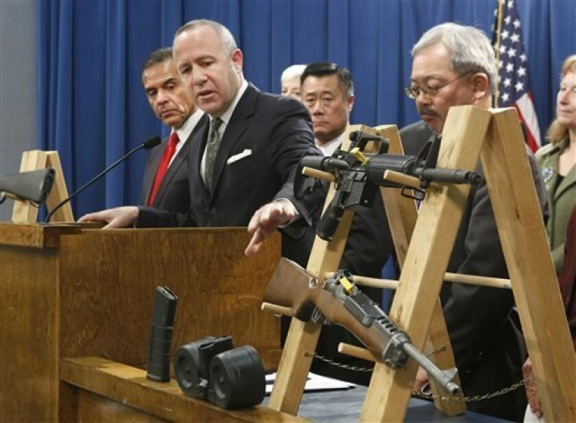 FILE - In this Feb. 7, 2013 file photo, Senate President Pro Tem Darrell Steinberg, second from left,  gestures to a pair of semi-automatic rifles as he discusses a package of proposed  gun control legislation at a Capitol news conference in Sacramento, Calif.  Gov. Jerry Brown vetoed Steinbergs's