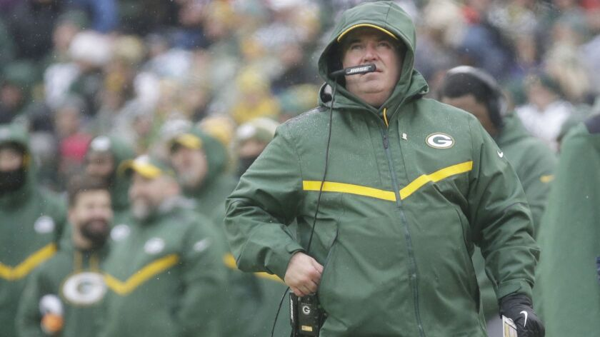 Green Bay Packers' Head Coach Mike McCarthy watches a replay on the scoreboard during the first half