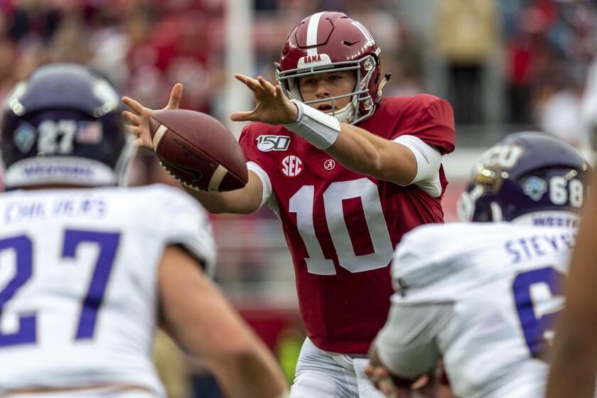 Alabama quarterback Mac Jones (10) grabs a wide snap from the shotgun position during the first half of an NCAA college football game against Western Carolina, Saturday, Nov. 23, 2019, in Tuscaloosa, Ala. (AP Photo/Vasha Hunt)