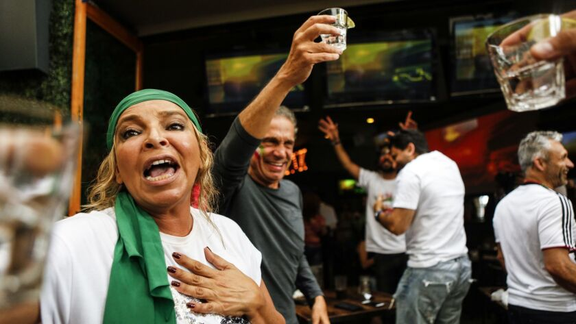 LOS ANGELES, CA -- FRIDAY, JUNE 15, 2018-- Mandy Molesten, left, cheers with a shot of tequila afte