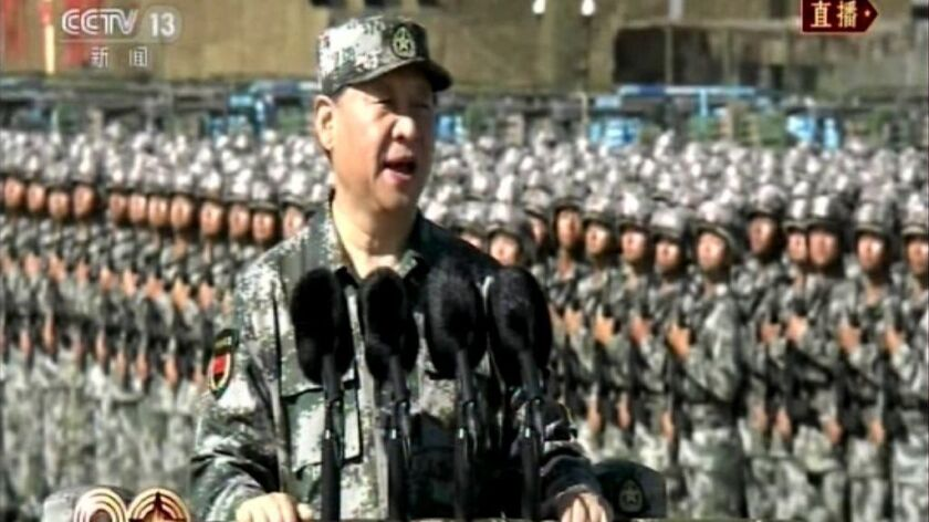 In this image taken from video, Chinese President Xi Jinping inspects troops of the People's Liberat