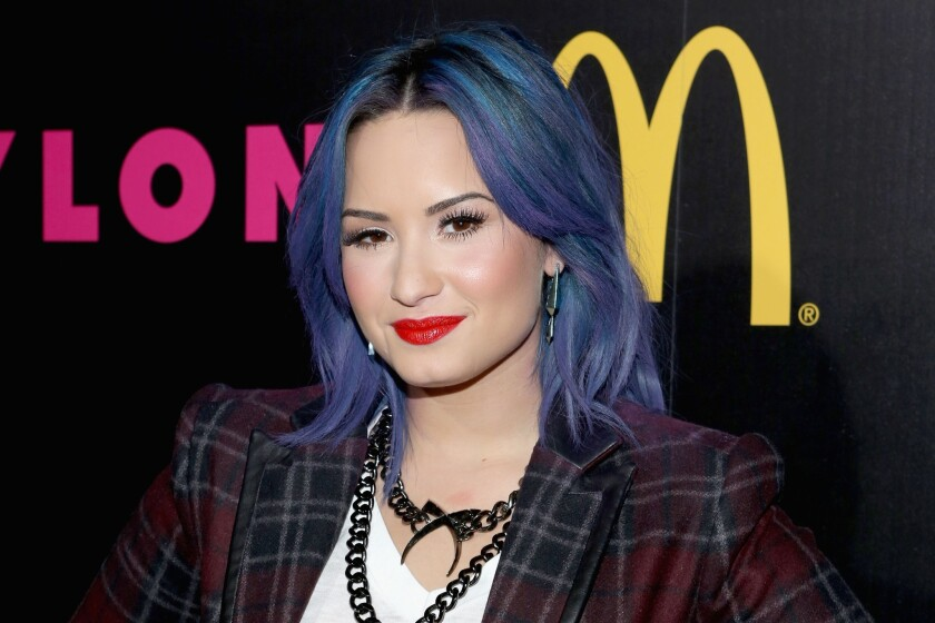 Demi Lovato said she hit bottom when she was on the way to the airport at 9 a.m. with a Sprite bottle filled with vodka, headed back to a sober-living facility she was staying at and throwing up in the car. She said she realized that was alcoholic behavior.