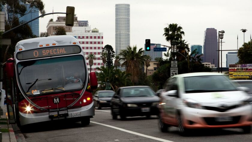 A Metro bus moves through traffic on Wilshire Boulevard west of downtown Los Angeles in 2013.
