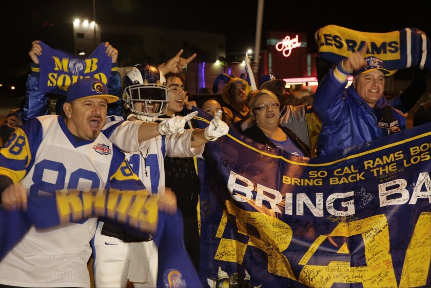 Football fans cheer for the return of the Rams to Los Angeles on the site of the old Hollywood Park racetrack in Inglewood on Jan. 12.