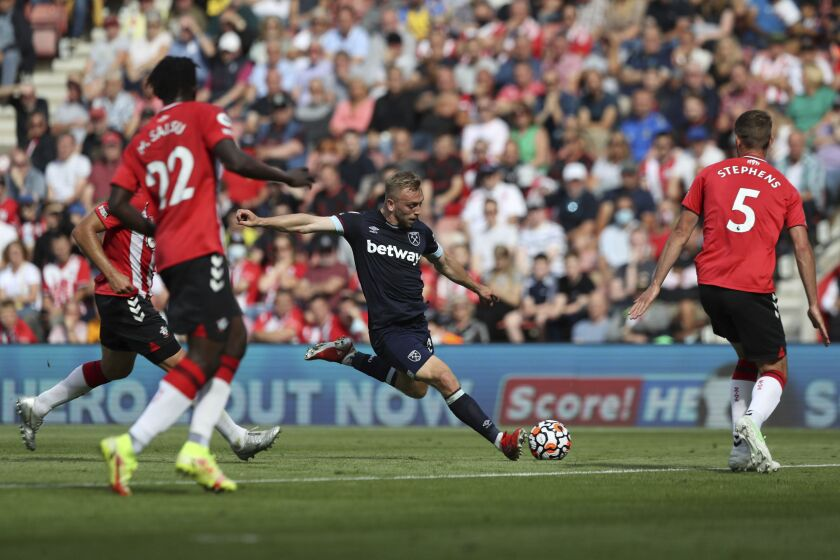 West Ham United's Jarrod Bowen shoots at goal, during the English Premier League soccer match between Southampton and West Ham United, at St Mary's Stadium, in Southampton, England, Saturday, Sept. 11, 2021. (Kieran Cleeves/PA via AP)