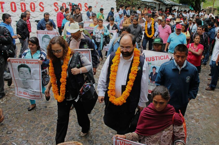 Rose-Marie Belle Antoine, president, and Emillio Alvarez Icaza, executive secretary, of the Inter-American Commission on Human Rights, are received by parents and relatives of the 43 missing students at Ayotzinapa in the southern state of Guerrero on Sept. 29, 2015.