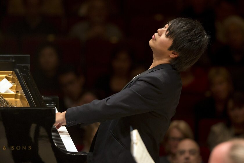 Pianist Lang Lang accompanied  the San Diego Symphony Tuesday night for their first concert at Carnegie Hall before a sold-out audience.