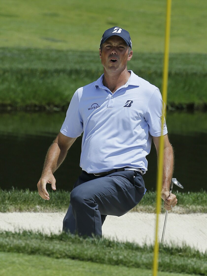Matt Kuchar reacts after hitting out of a bunker on the ninth hole during the second round of the Memorial golf tournament, Friday, June 3, 2016, in Dublin, Ohio. (AP Photo/Darron Cummings)