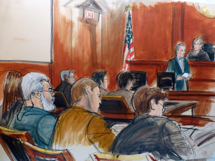In this artist's sketch, radical Muslim cleric Abu Hamza Masri, left, sits in court as the verdict is read in his terrorism trial in New York on May 19.