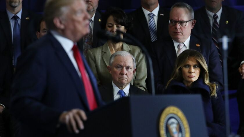 Atty. Gen. Jeff Sessions and First Lady Melania Trump watch as President Trump speaks about the opioid epidemic in Manchester, N.H., on March 19.