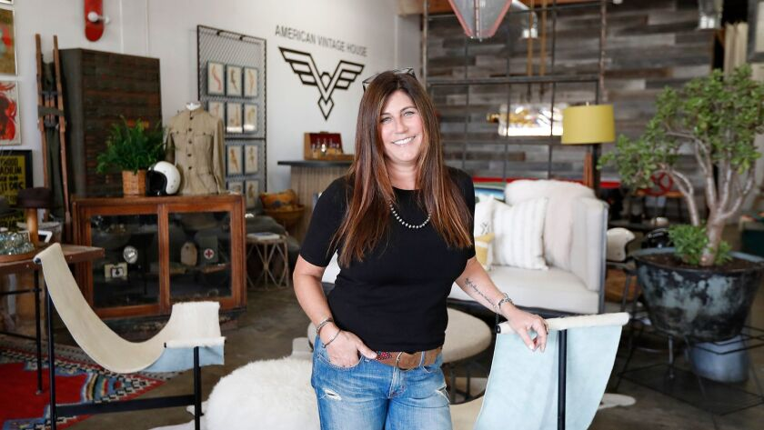 Owner JoAnn Sarvak poses in her showroom, filled with vintage items from the 50's, 60's and 70's, at