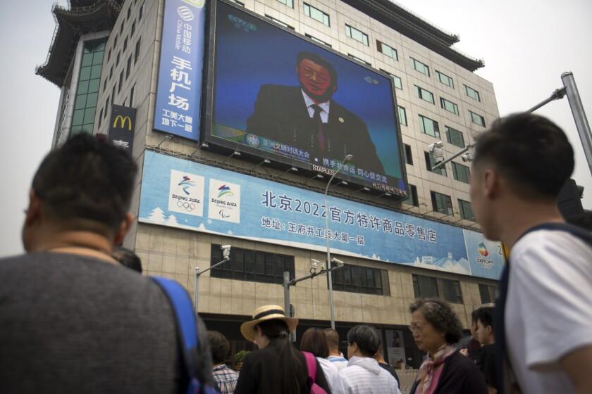 A video screen in Beijing shows Chinese President Xi Jinping.