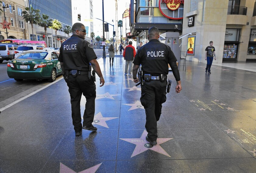 Violent crime in Hollywood has increased 21% this year through Oct. 10, compared with the same period last year. Above, LAPD officers in the district in January.