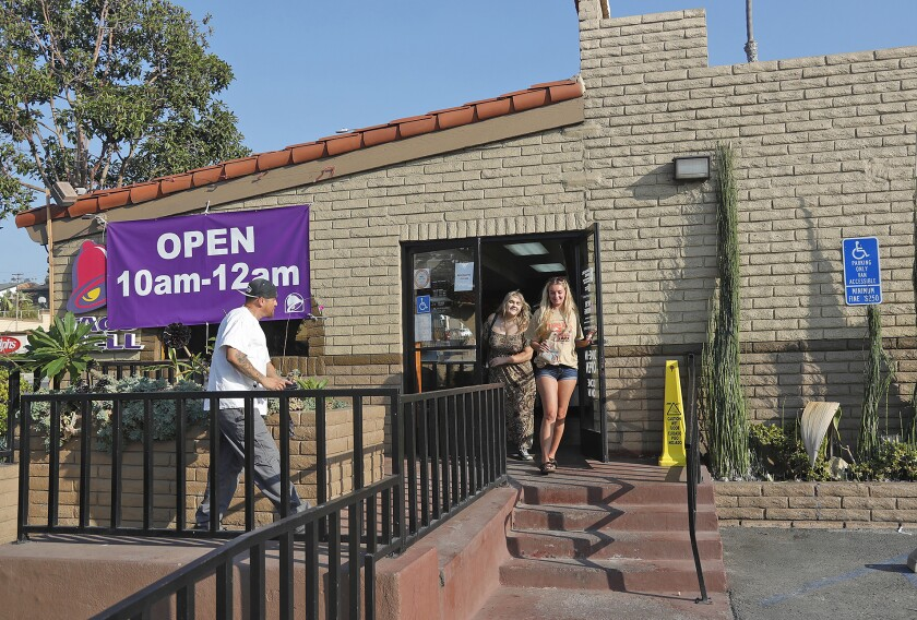 Customers at the Laguna Beach Taco Bell, which closed its doors Tuesday after more than 54 years of service.