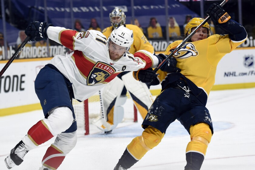 Florida Panthers left wing Jonathan Huberdeau (11) pushes Nashville Predators center Mikael Granlund (64) as they chased the puck during the third period of an NHL hockey game Thursday, March 4, 2021, in Nashville, Tenn. (AP Photo/Mark Zaleski)