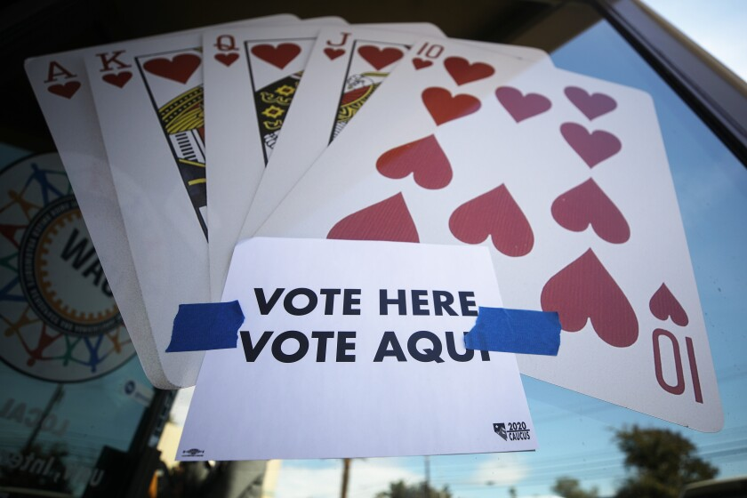 A sign in Las Vegas draws in voters on Tuesday, the last day of early voting in Nevada.
