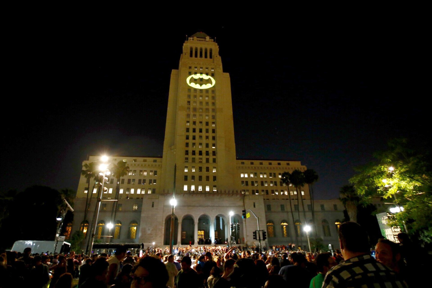 The Bat-signal is projected onto Los Angles City Hall during a tribute to pop-culture icon Adam West.
