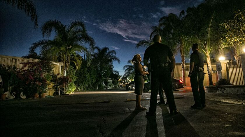 LAPD officers investigate a reported disturbance in a Sylmar mobile home park.