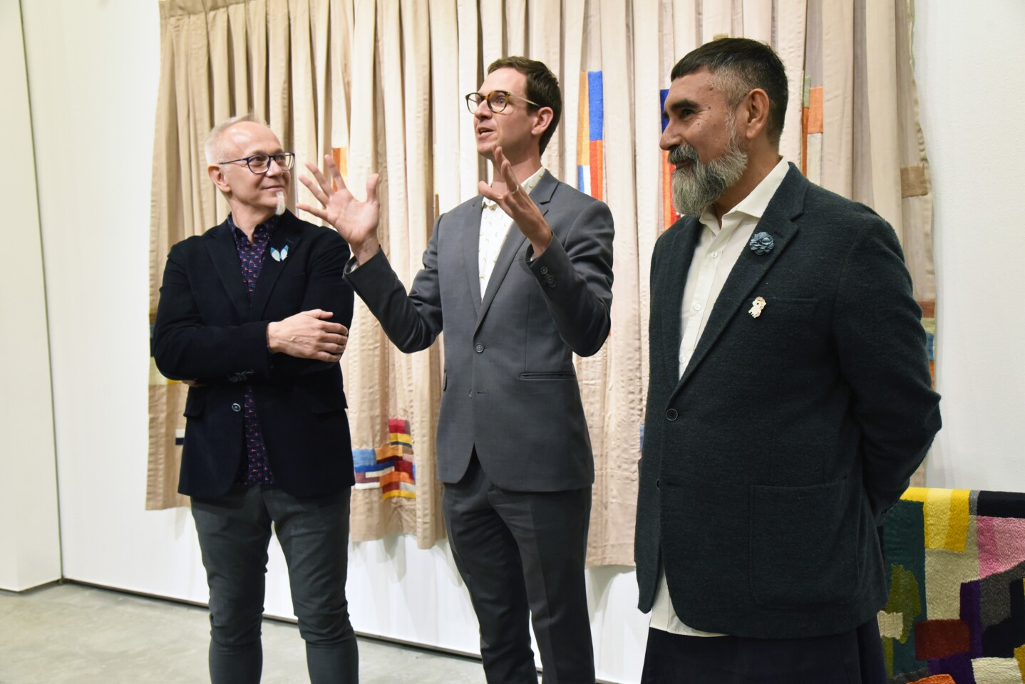 Lux Executive Director Andrew Utt (center) welcomes artists-in-residence Daniel Giannone and Leo Chiachio