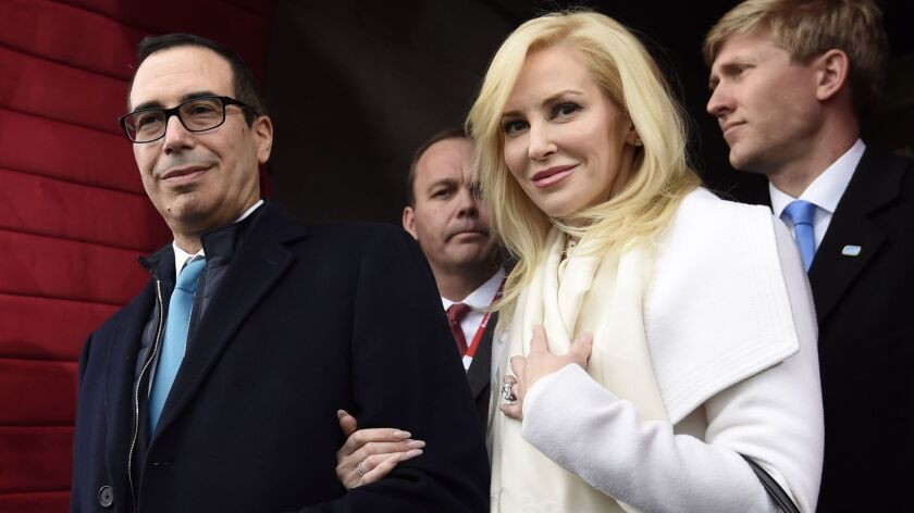 Stephen Mnuchin and his then-fiancee, Louise Linton, arrive on Capitol Hill in Washington for the presidential inauguration of Donald Trump in 2017.