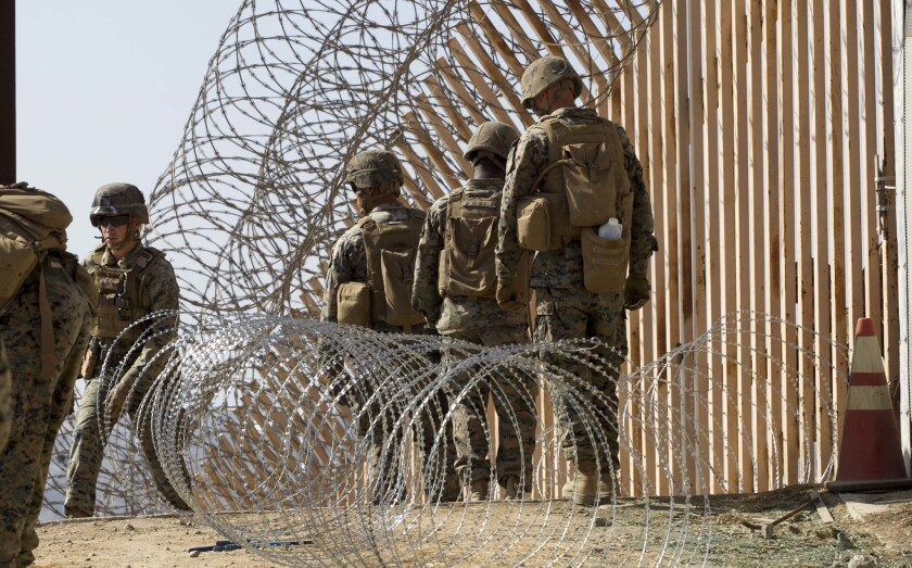 In this November 2018 file photo, USMC engineers from Camp Pendleton worked putting up razor wire just east of the San Ysidro Port of Entry.