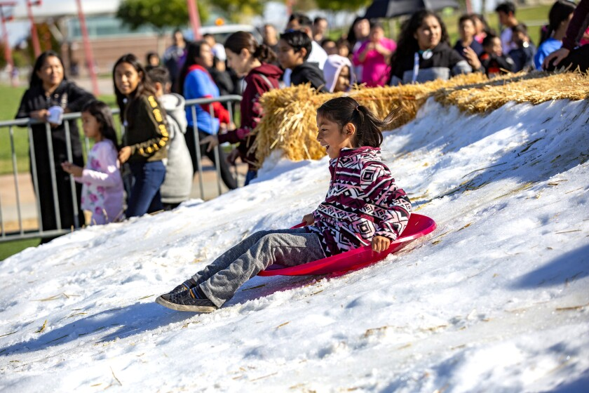 Play in the snow at Winter Wonderland in Wilmington on Dec. 7.