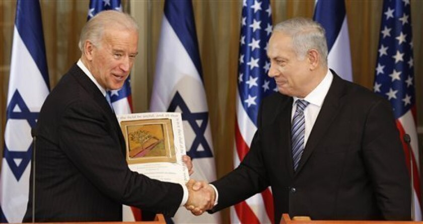 """U.S Vice President Joe Biden, left, shakes hand  with Israel's Prime Minister Benjamin Netanyahu at the Prime Minister's residence in Jerusalem, Tuesday, March 9, 2010.  Biden said there is a """"moment of opportunity"""" for peace between Israelis and Palestinians.(AP Photo/Ariel Schalit)"""