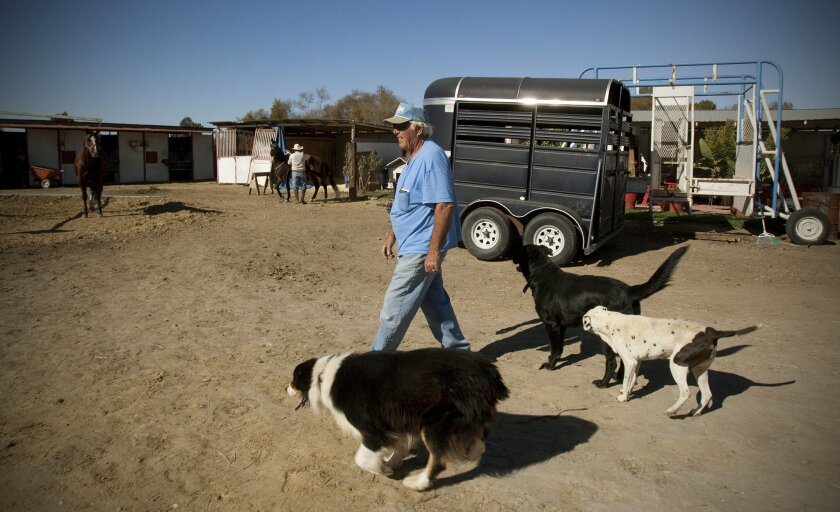 Rancher Dick Tynan is worried that stalled dredging work in the Tijuana River Valley will create flooding this winter.